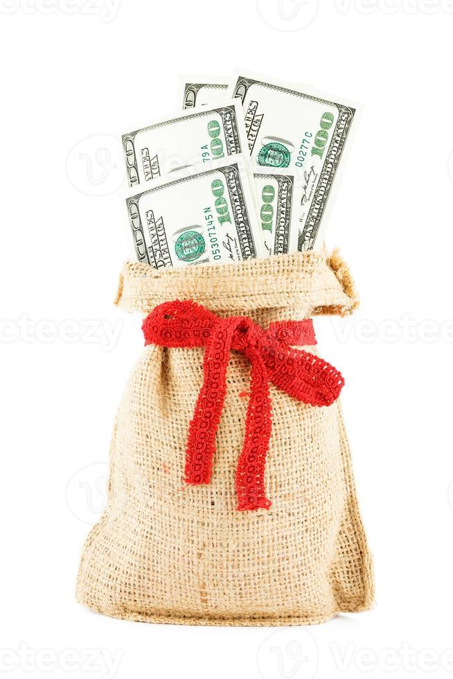 los dólares en un saco de lino foto