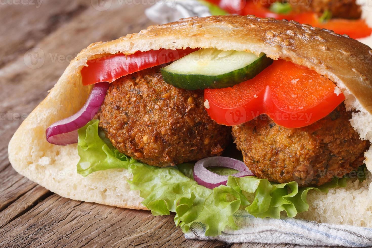 falafel with fresh vegetables in pita bread close-up photo