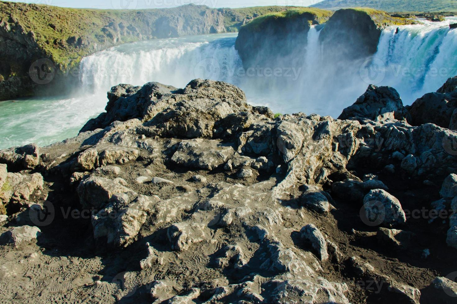 Beautiful vibrant panorama picture with view on waterfall in iceland photo