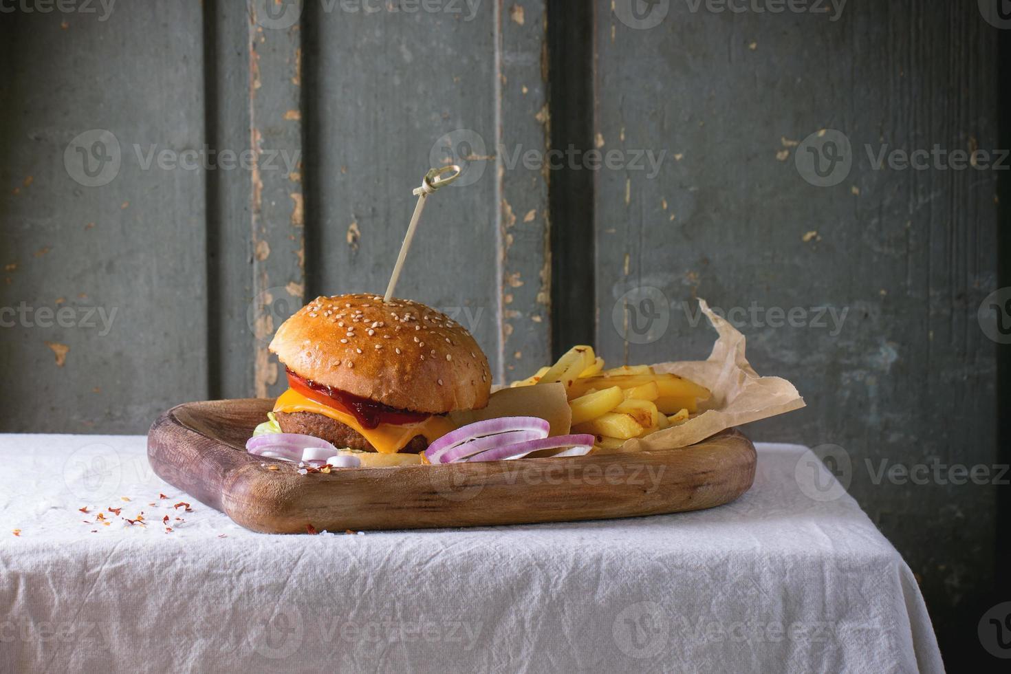 Burger and potatoes photo