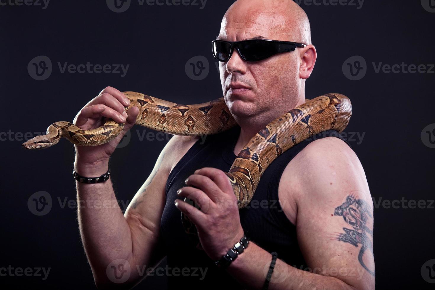 Mafia guy with snake photo