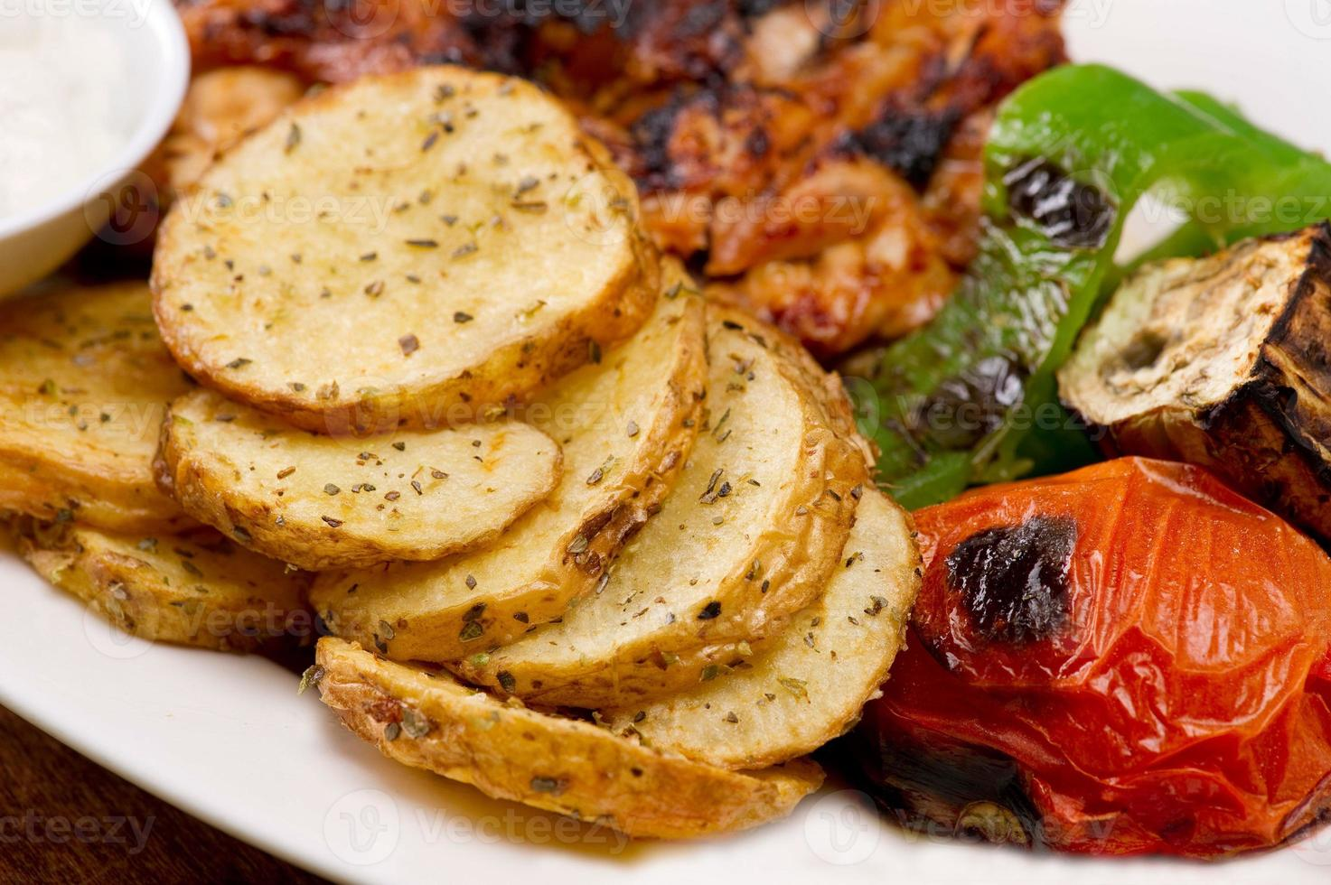 Grilled chicken fillets, with potatoes and vegetables photo