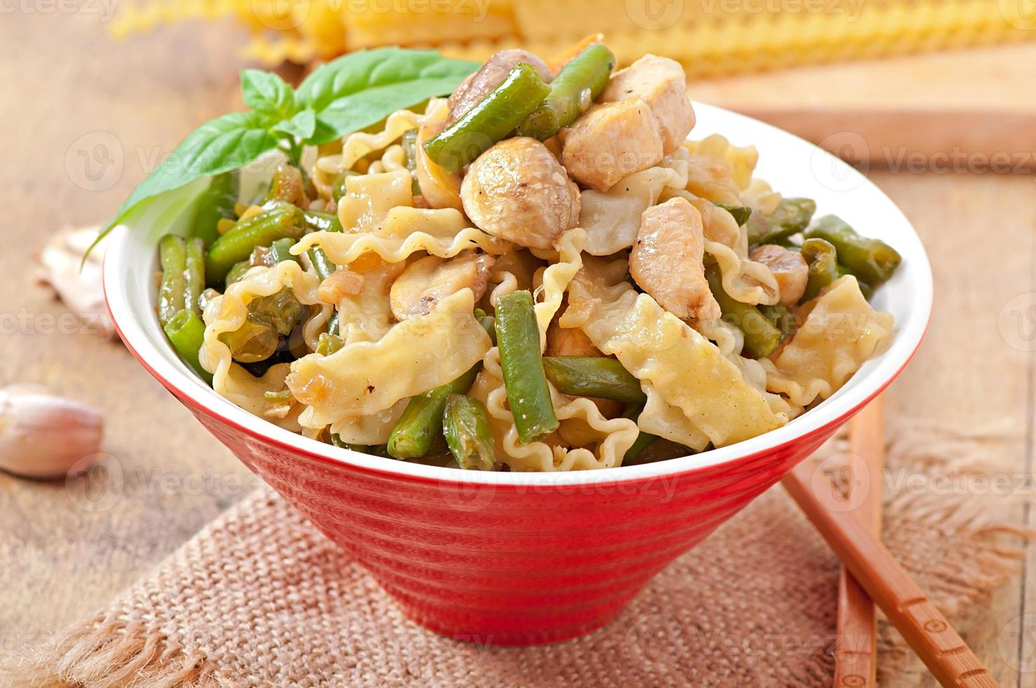 Noodles with meat, beans and mushrooms photo