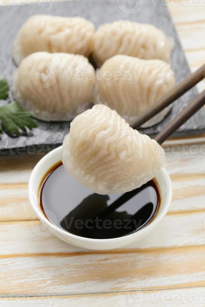 Asian steamed meat dumplings dim sum with soy sauce photo