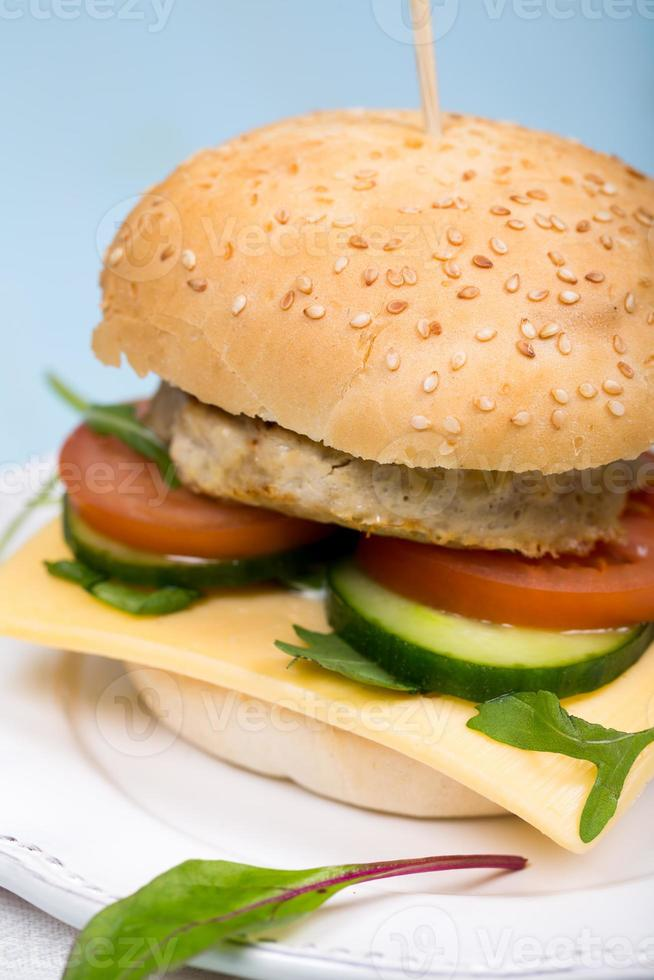 Homemade burger with beef cutlet and vegetables photo