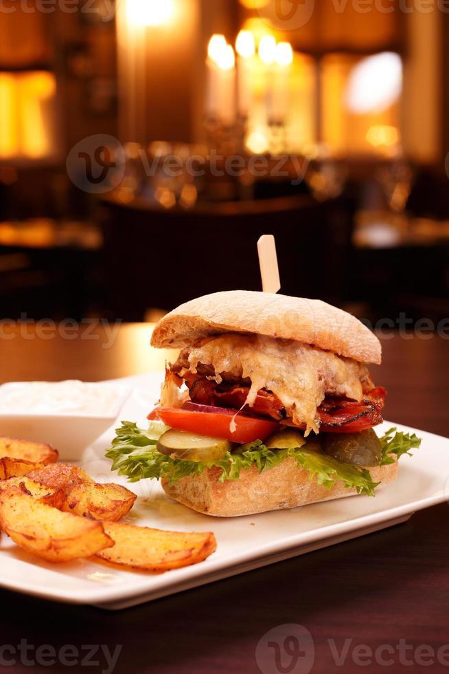 Ciabatta lamb burger with fried potatoes photo