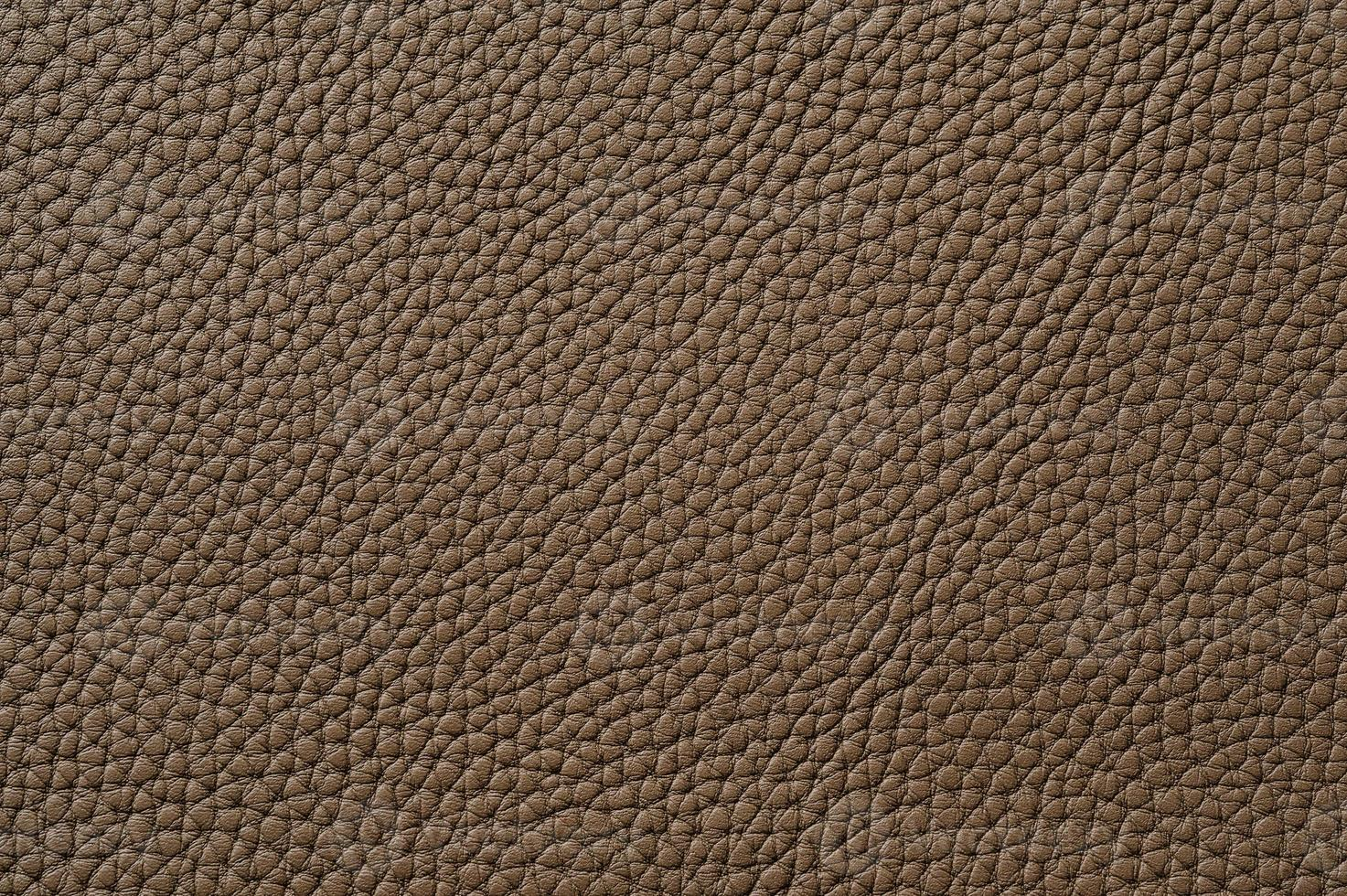 Closeup of seamless brown leather texture photo