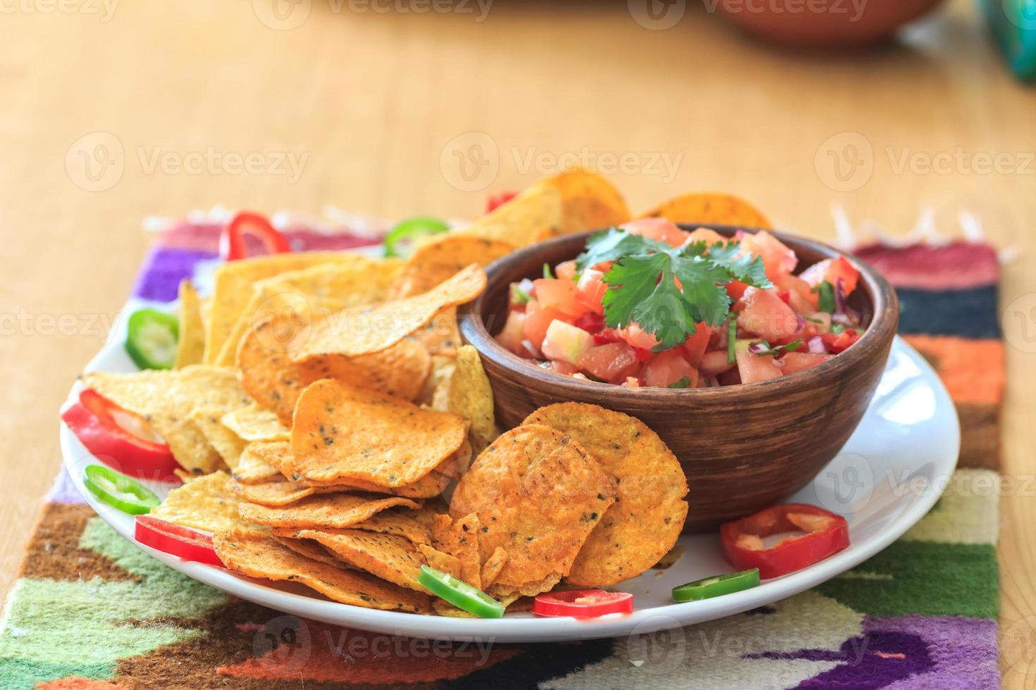 Mexican nachos with homemade scarlet red hot salsa photo