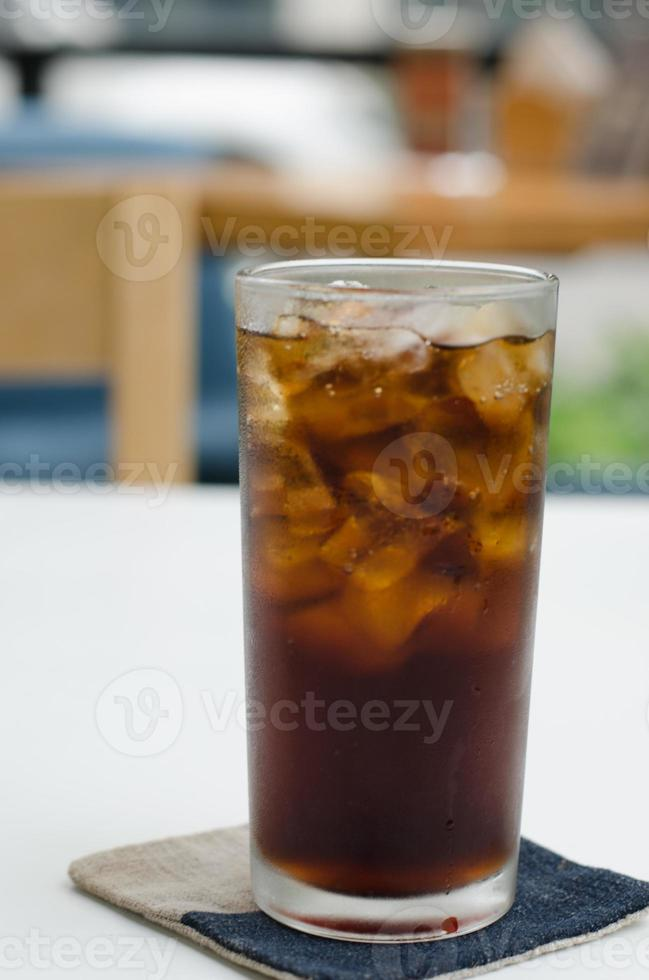 Cold soda iced drink in a glasses photo