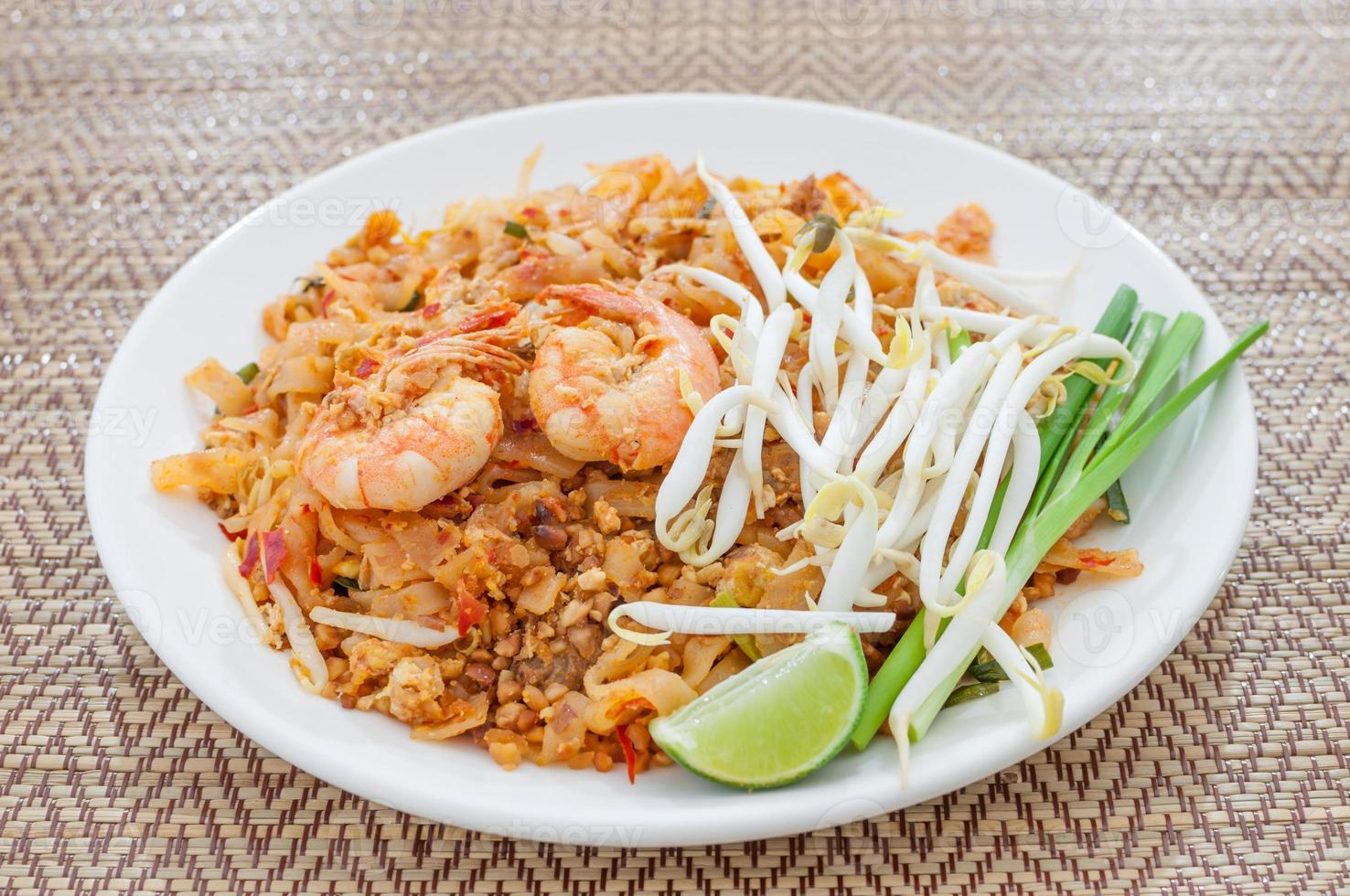 fried noodles thai style with prawns (pad thai) photo