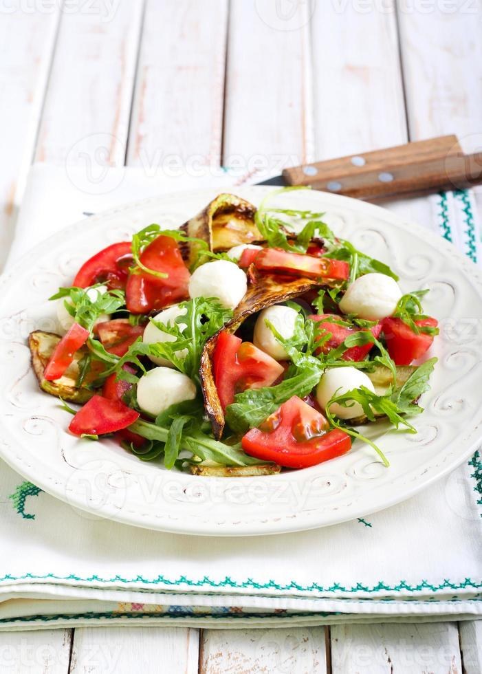 Zucchini, mozzarella, tomato  and rocket salad photo