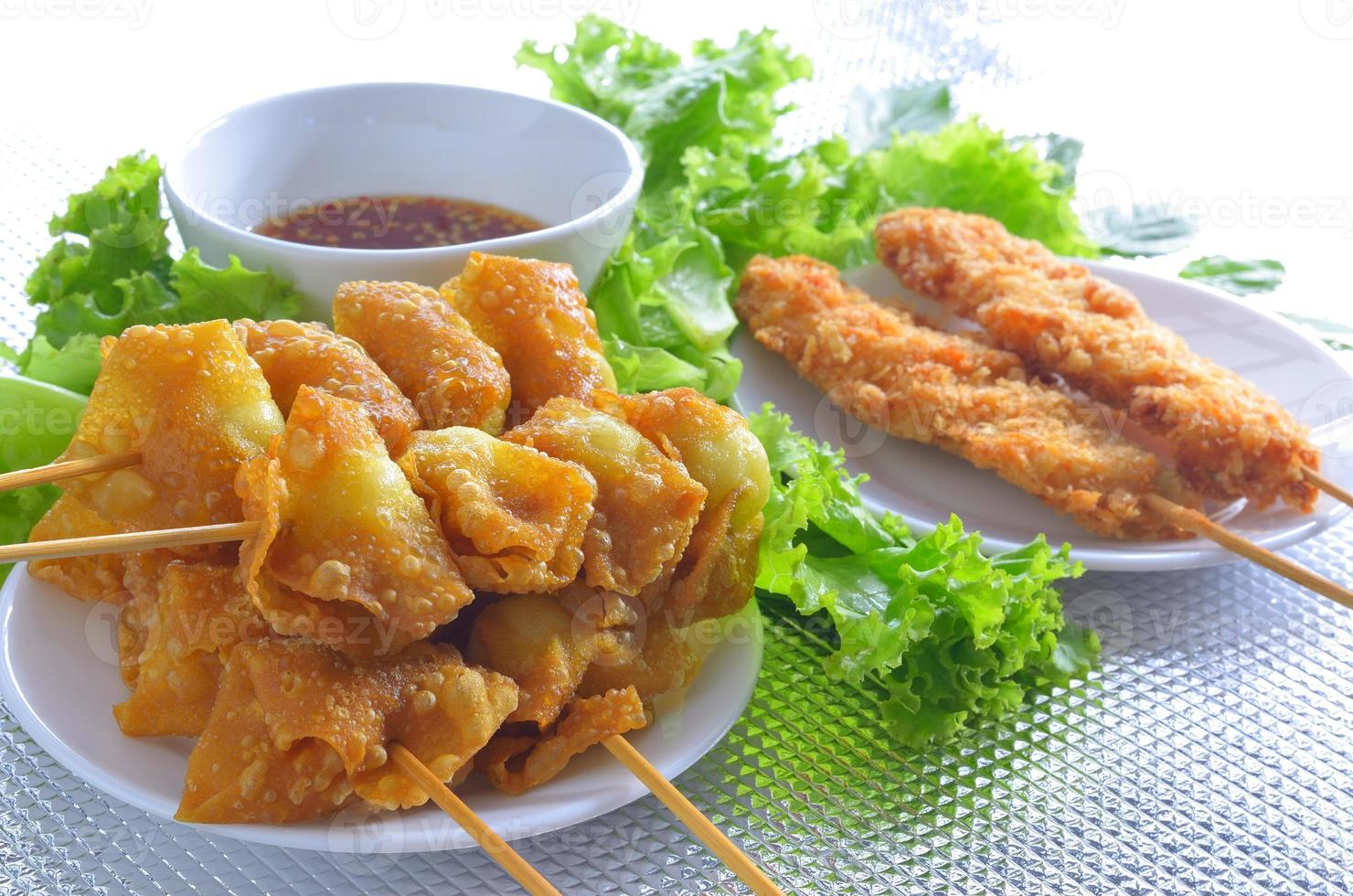 fried quail egg wrapped in wanton sheet and chicken photo