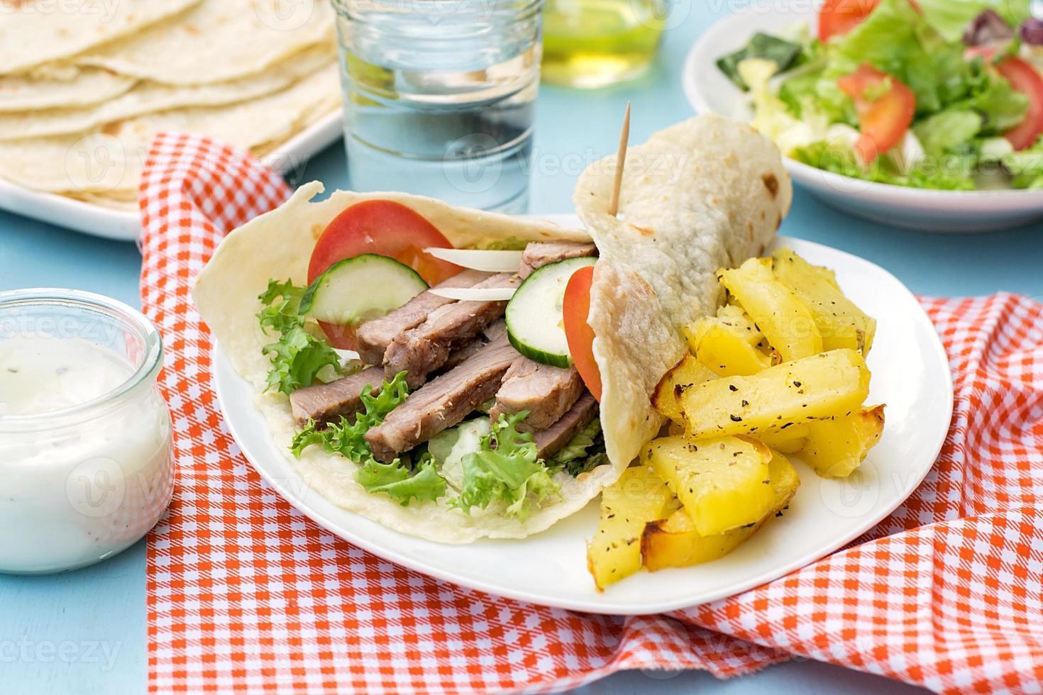 Greek gyros with pork, vegetables and homemade pita bread photo