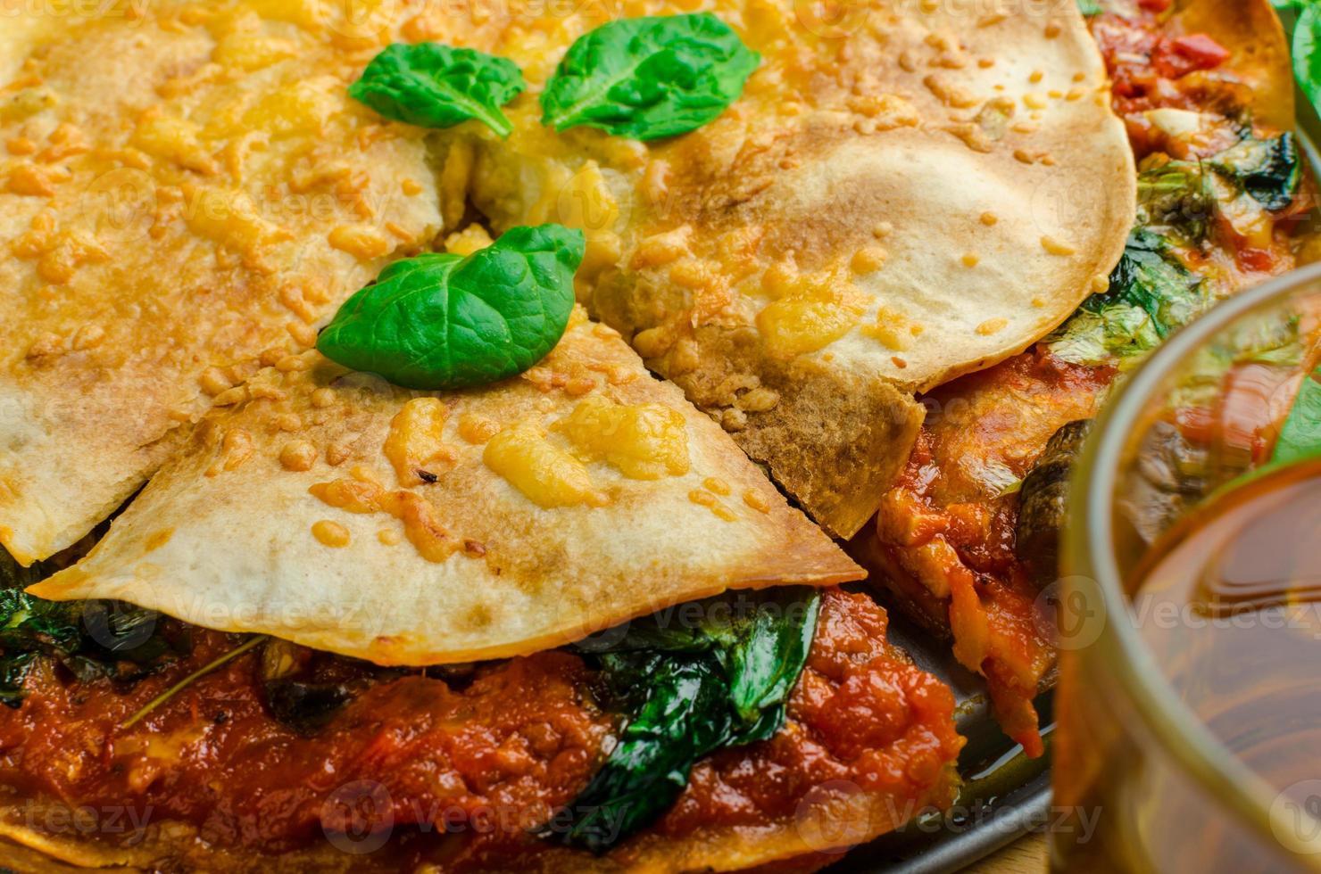 Vegetarian tortilla and bolognese sauce photo