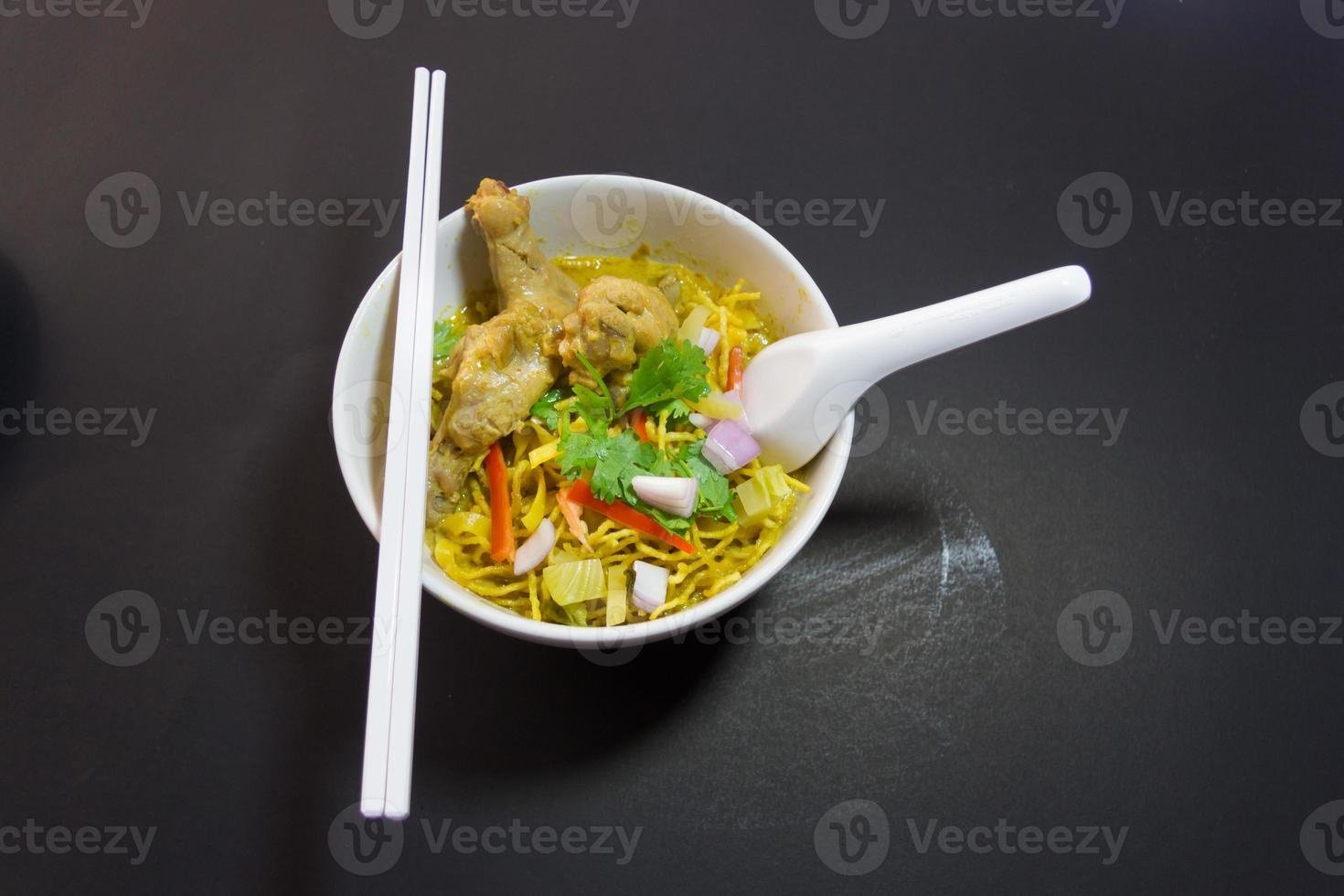 Khao Sawy Northern Thai Noodle Curry Soup  with chicken photo