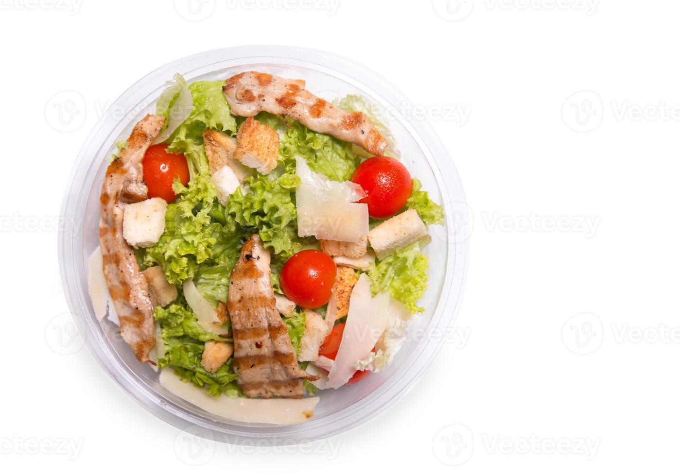 Caesar salad with grilled chicken meat, top view photo