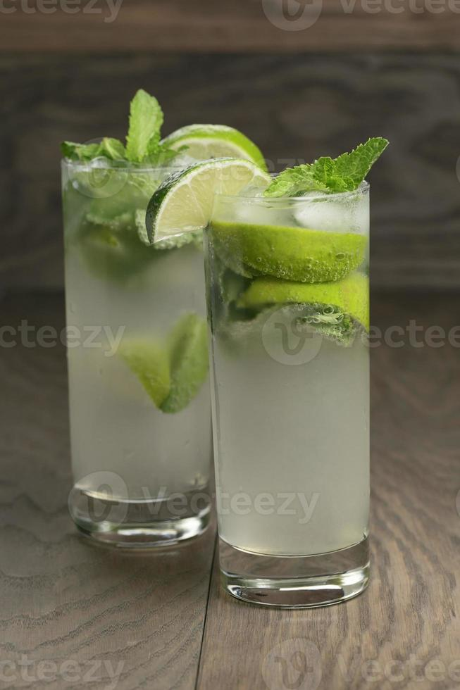 two mojito cocktails on old oak table photo