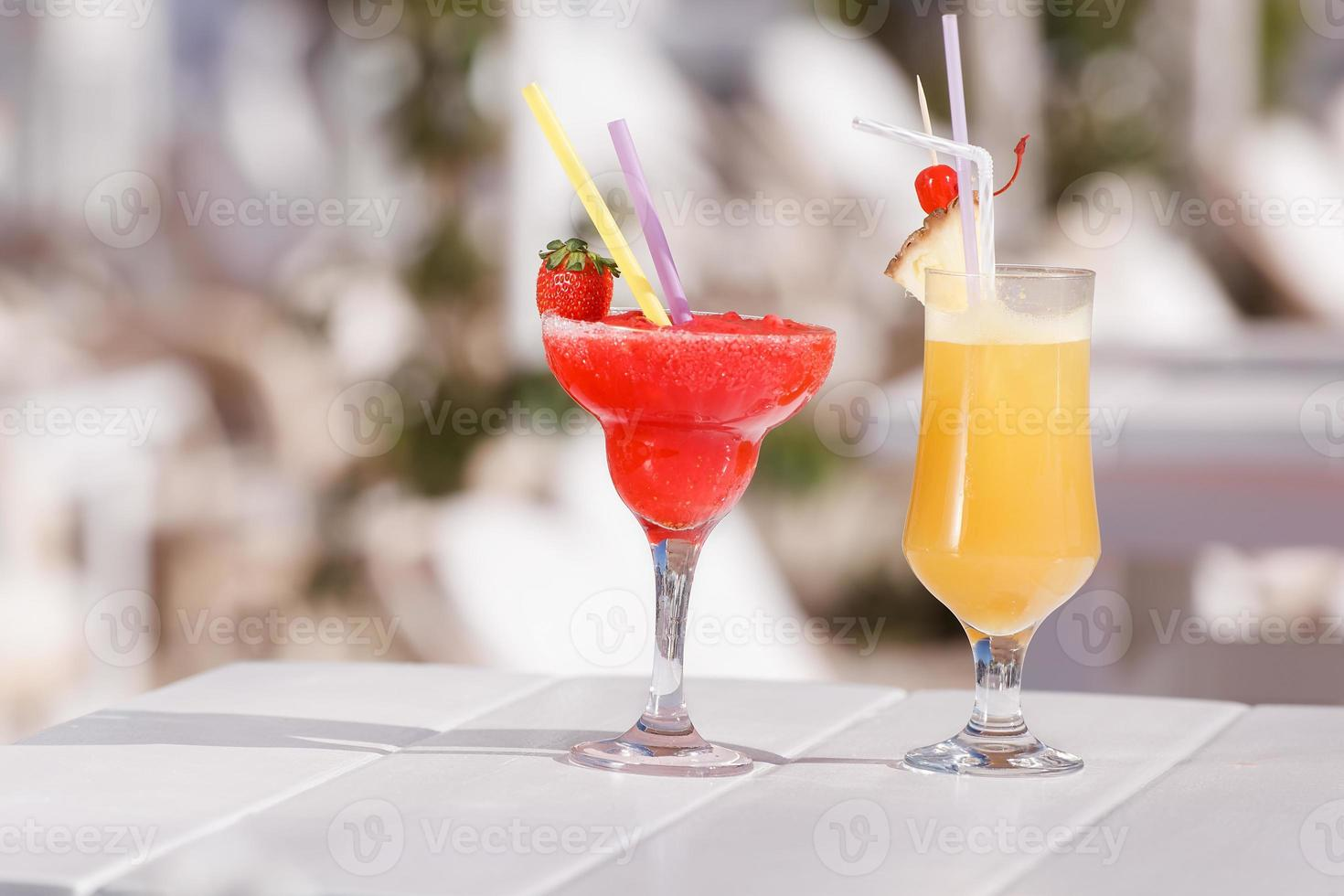 Two fresh cocktails on a bar table photo
