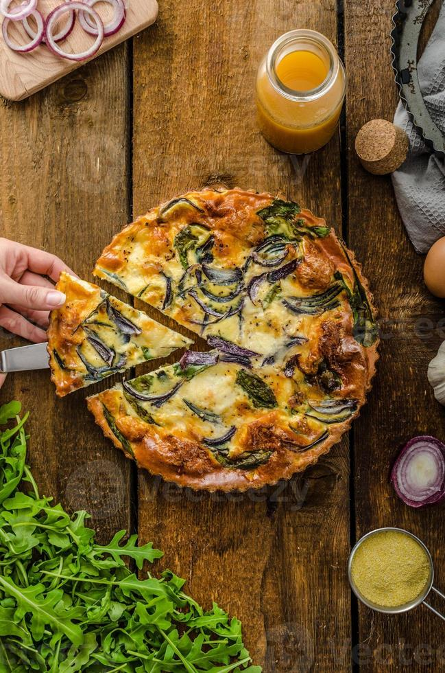 Polenta quiche with red onion and herbs photo