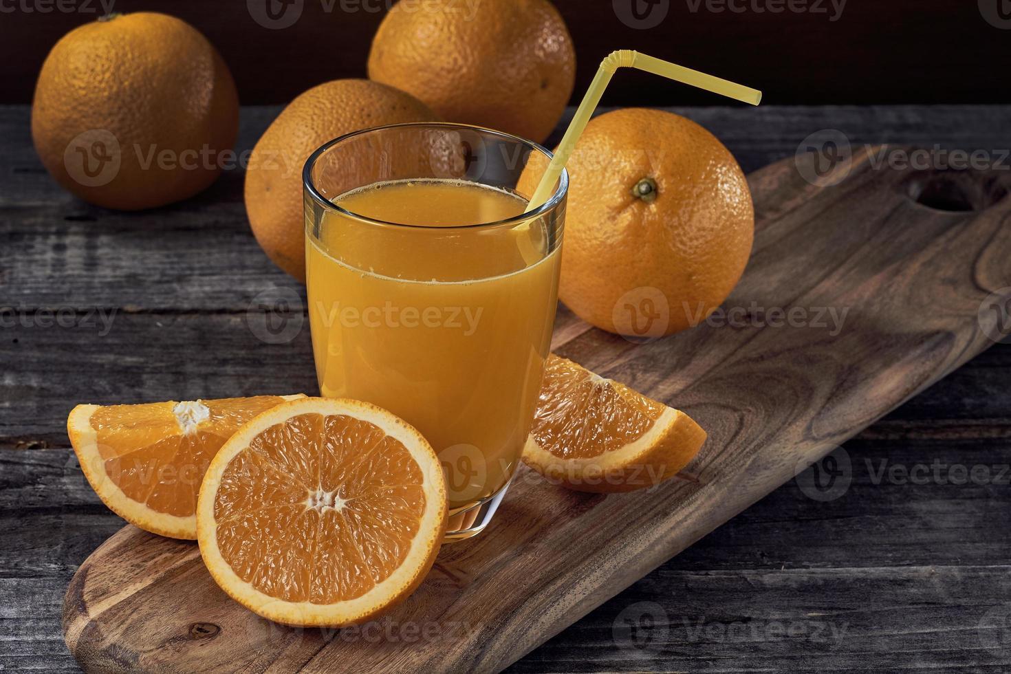 Orange juice on wooden table photo