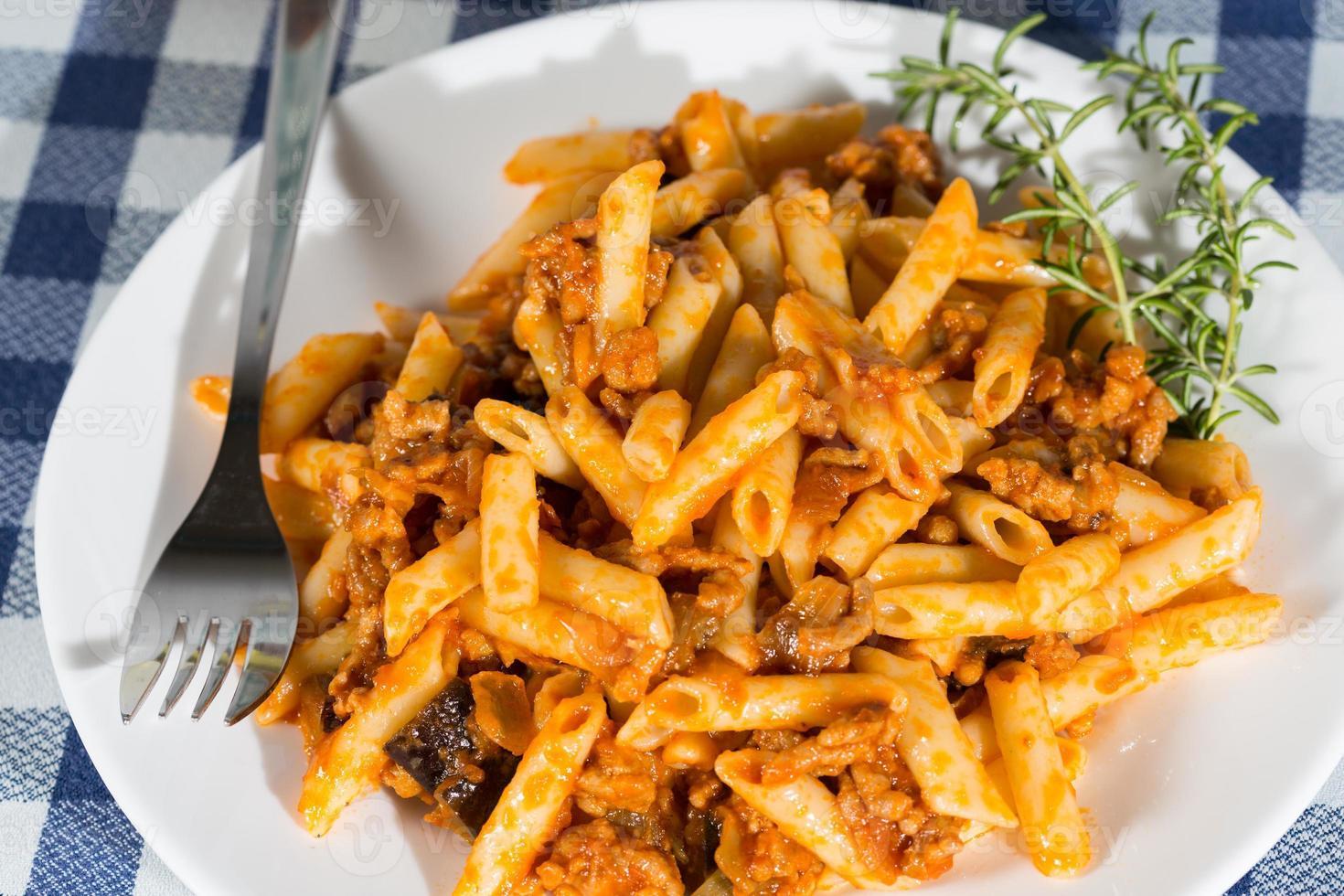 Macaroni with tomato photo