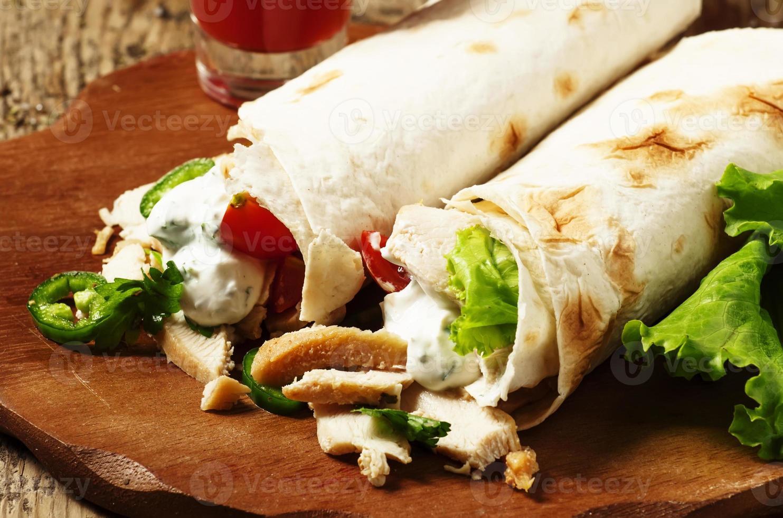 Turkish doner kebab, shawarma, roll with meat and pita bread photo