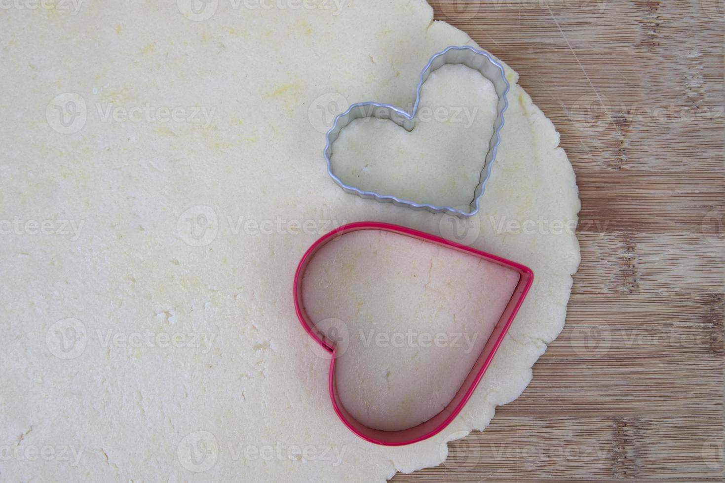 Sugar cookie dough with heart shaped cutters photo