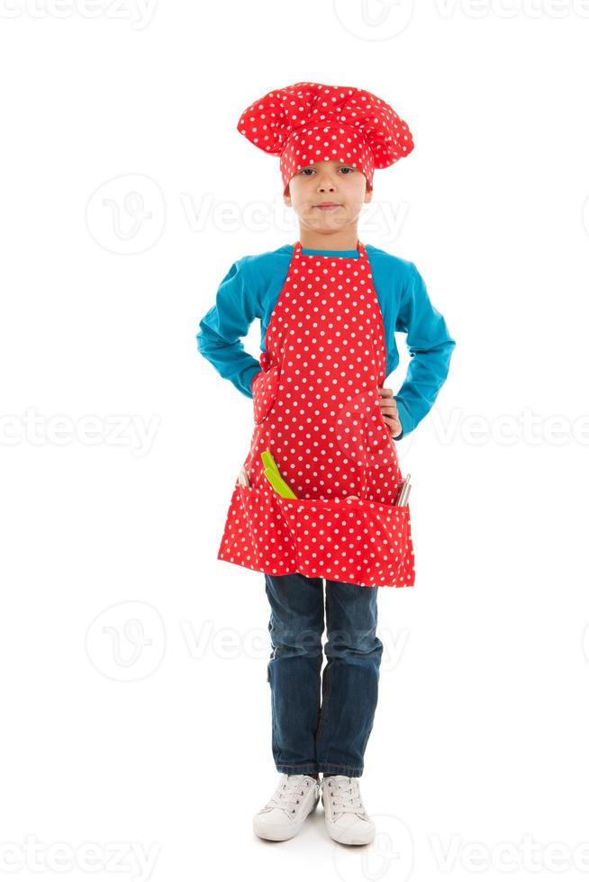 Studio portrait boy as little cook photo