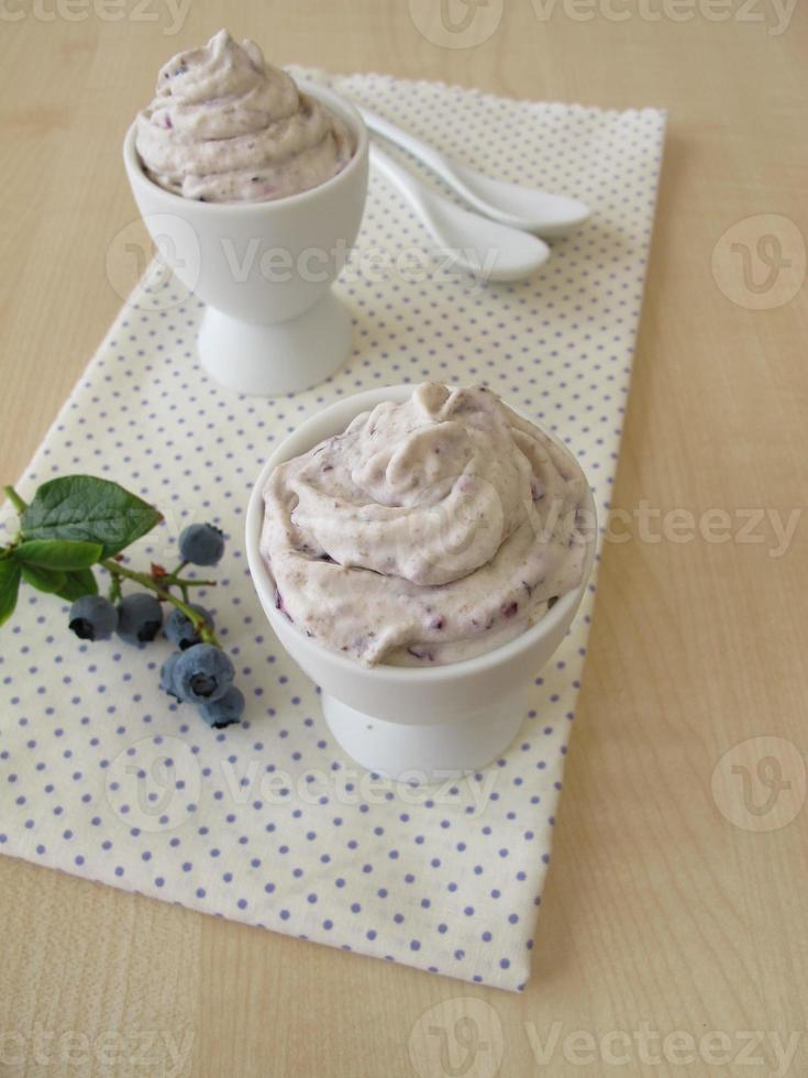 Blueberry ice cream in egg cup photo