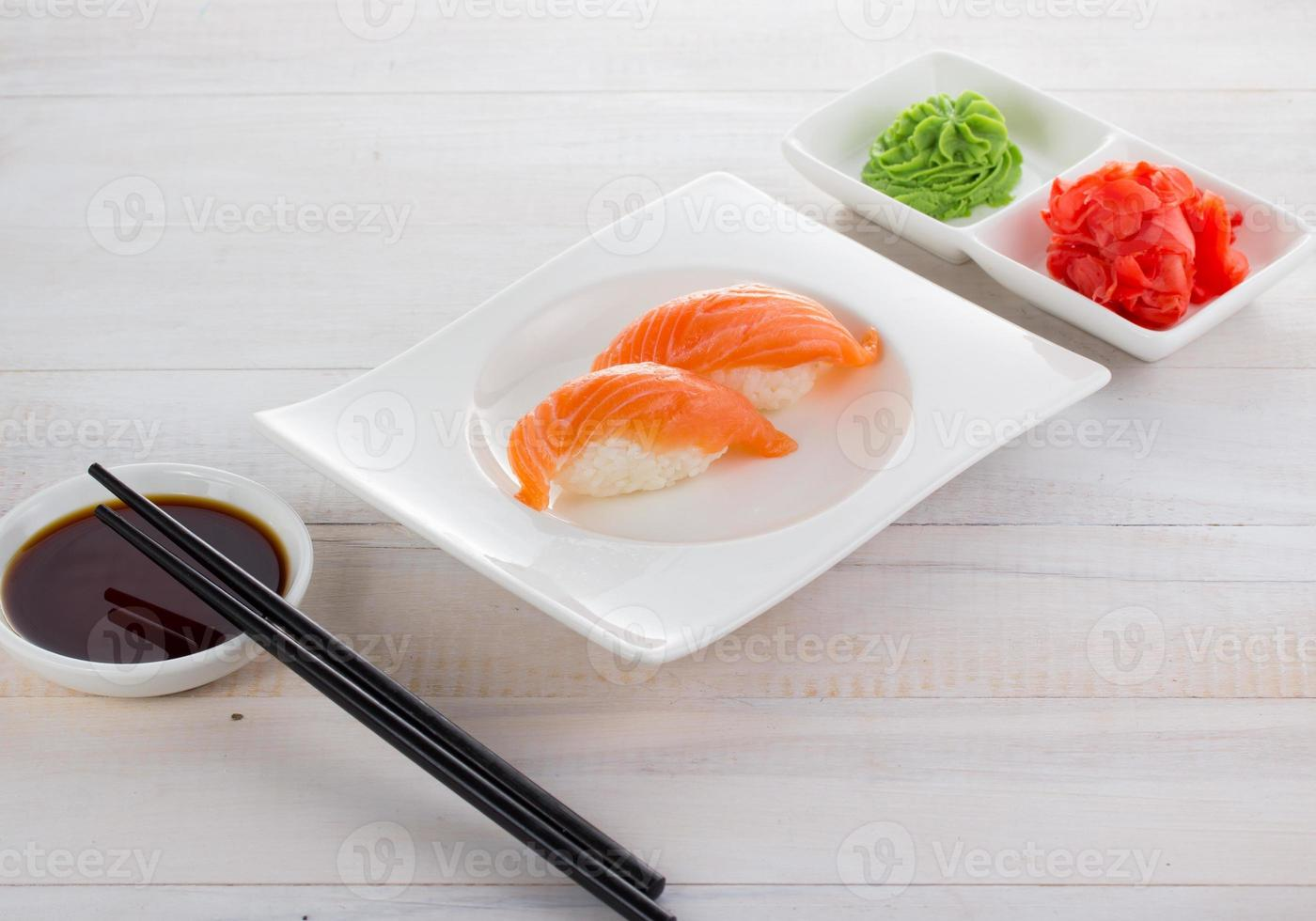 Japan cuisine. Sushi on a gete over wooden background photo