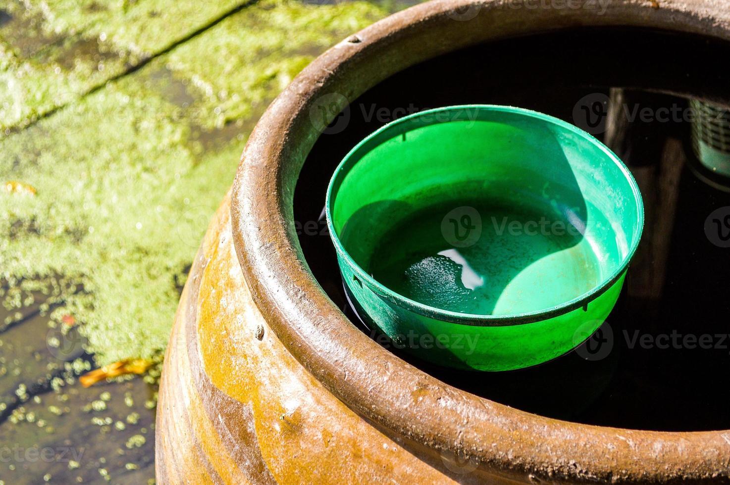 plastic water bowl on water jar photo