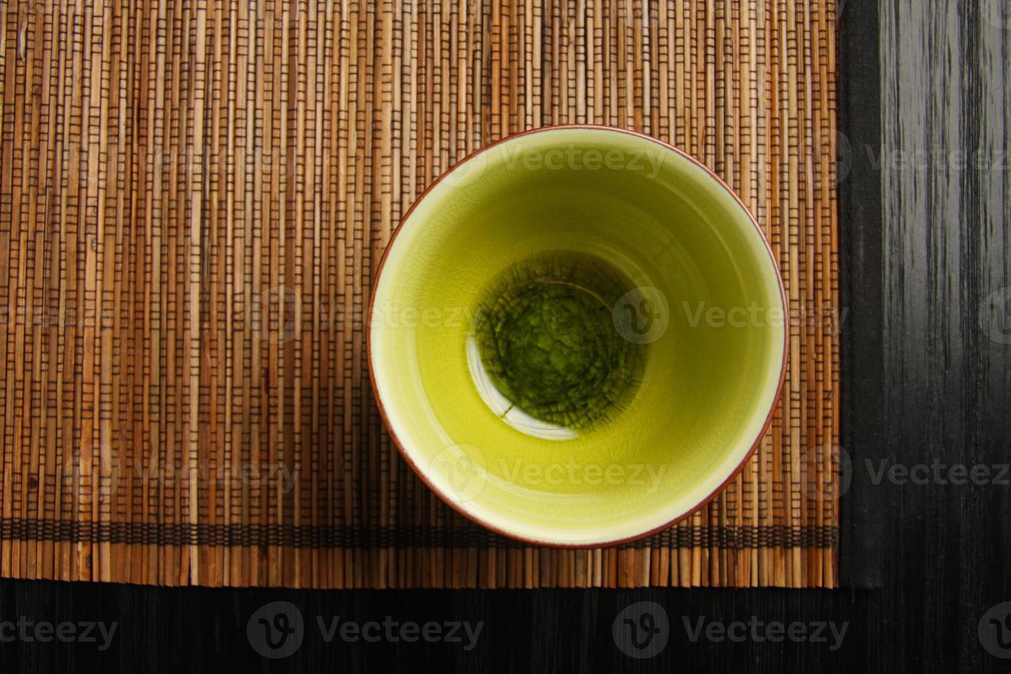 taza de té sobre una estera foto