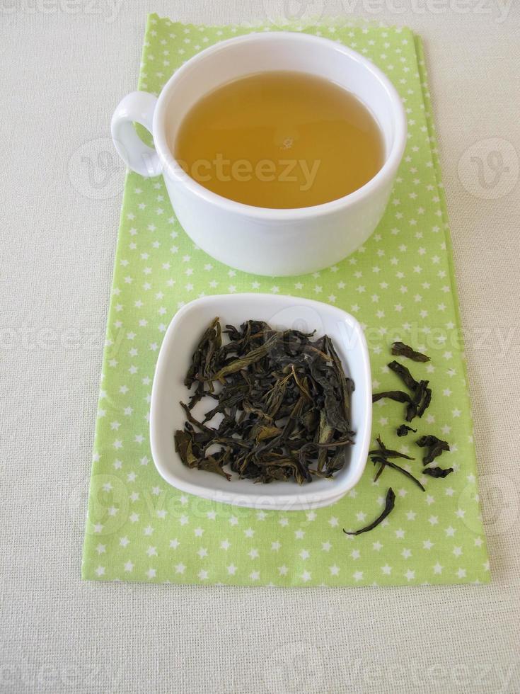 Loose ceylon royal silver white tea and cup of tea photo