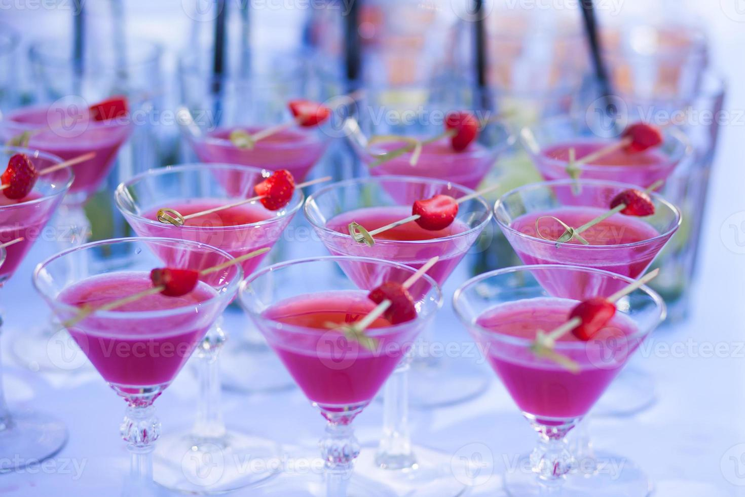 Line of different alcohol cocktails on event open-air night party photo