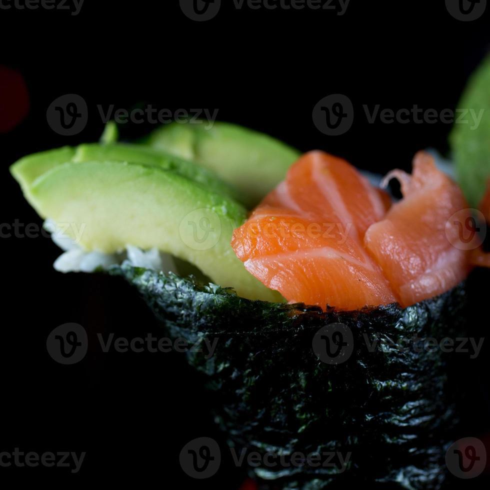 Salmon and avocado hand roll photo