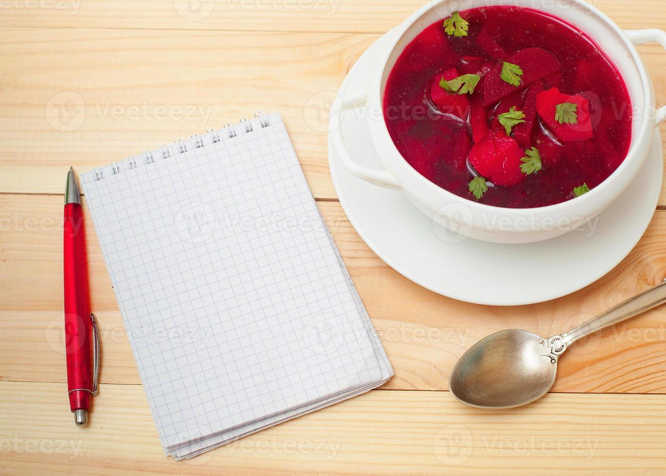 Red soup with dill photo