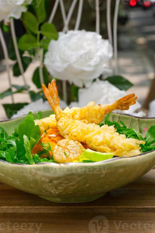 fresh Japanese tempura shrimps with salad photo