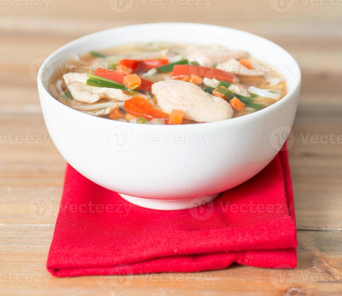 Bowls of Asian soup noodles photo