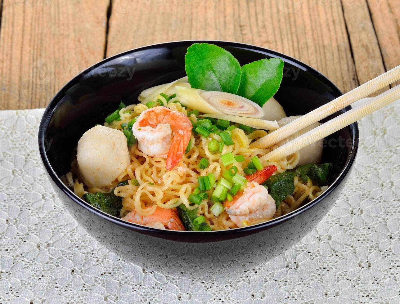 Hot and spicy instant noodle with shrimp and vegetable photo