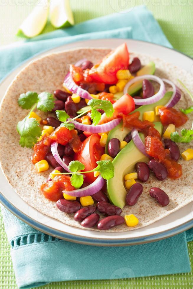 vegan taco with vegetable, kidney beans and salsa photo