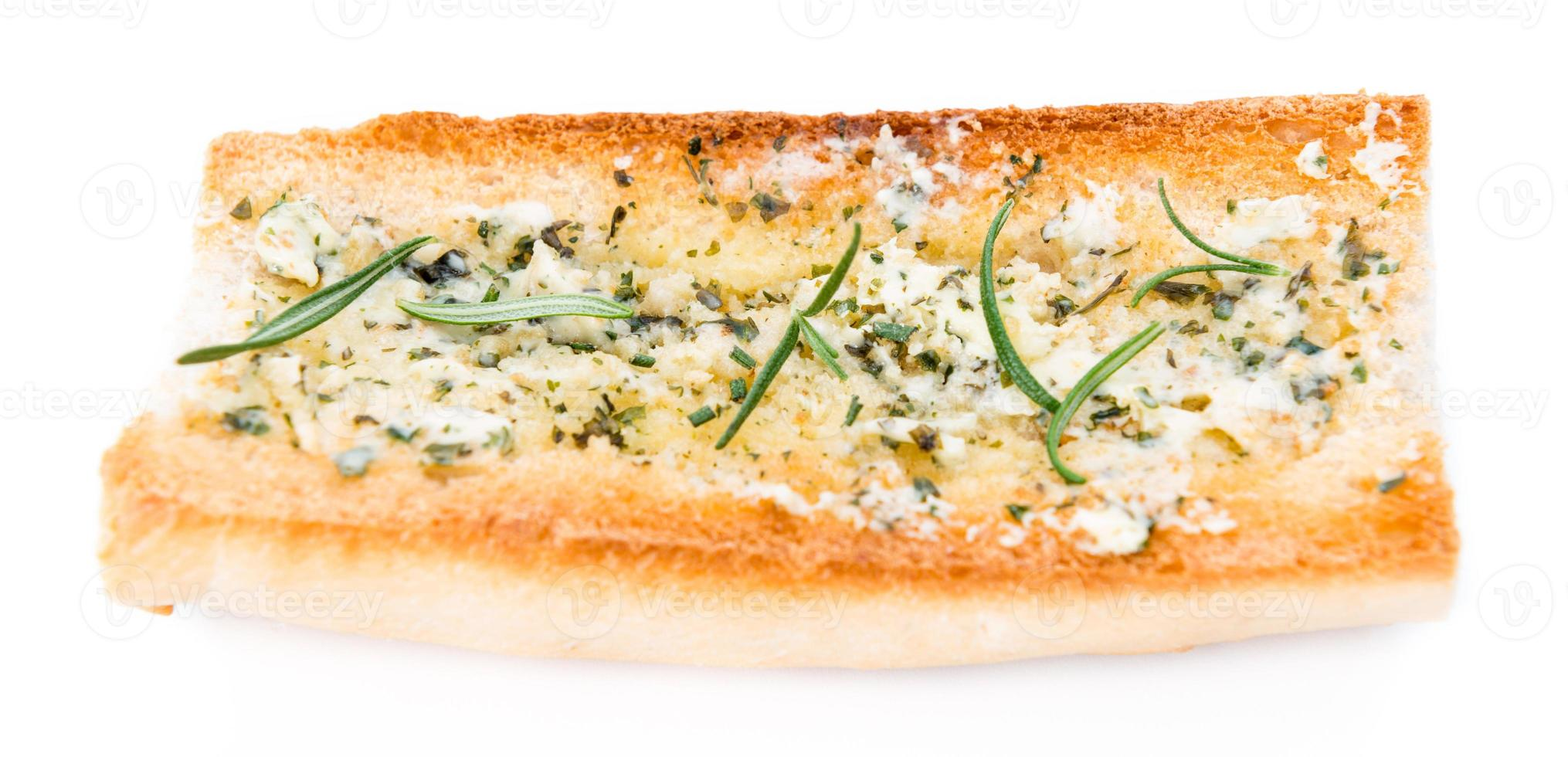 Herb Butter Baguette over white photo