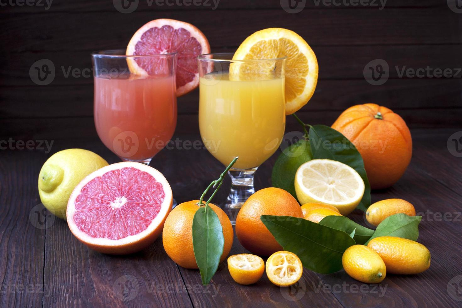 Fresh fruit juices on wooden table photo