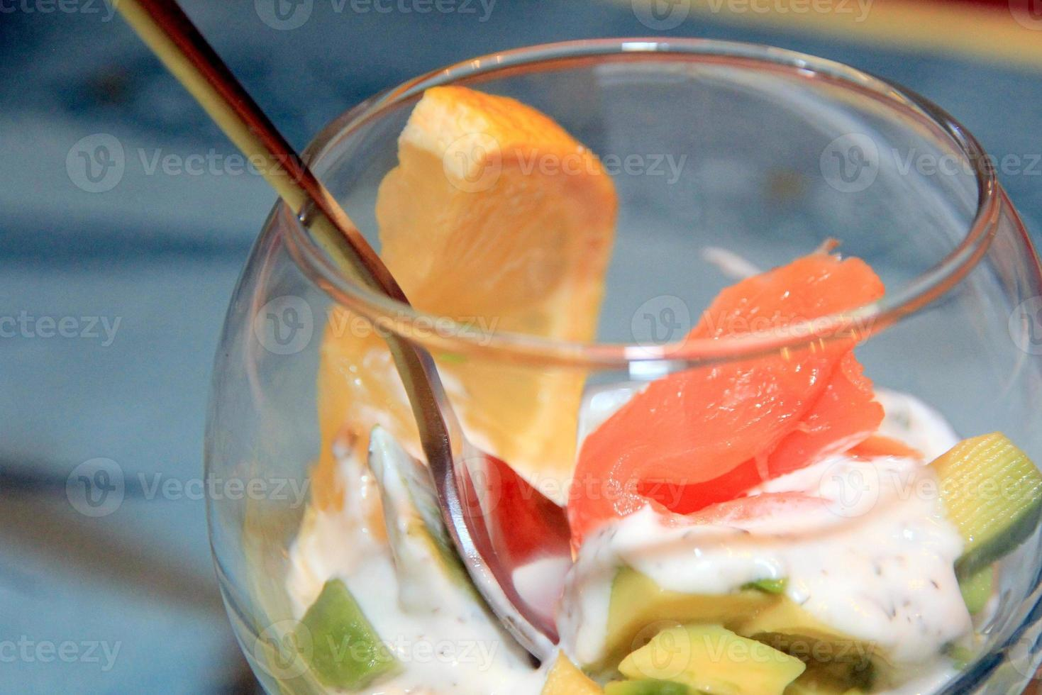 Glass cup with avocado and salmon photo