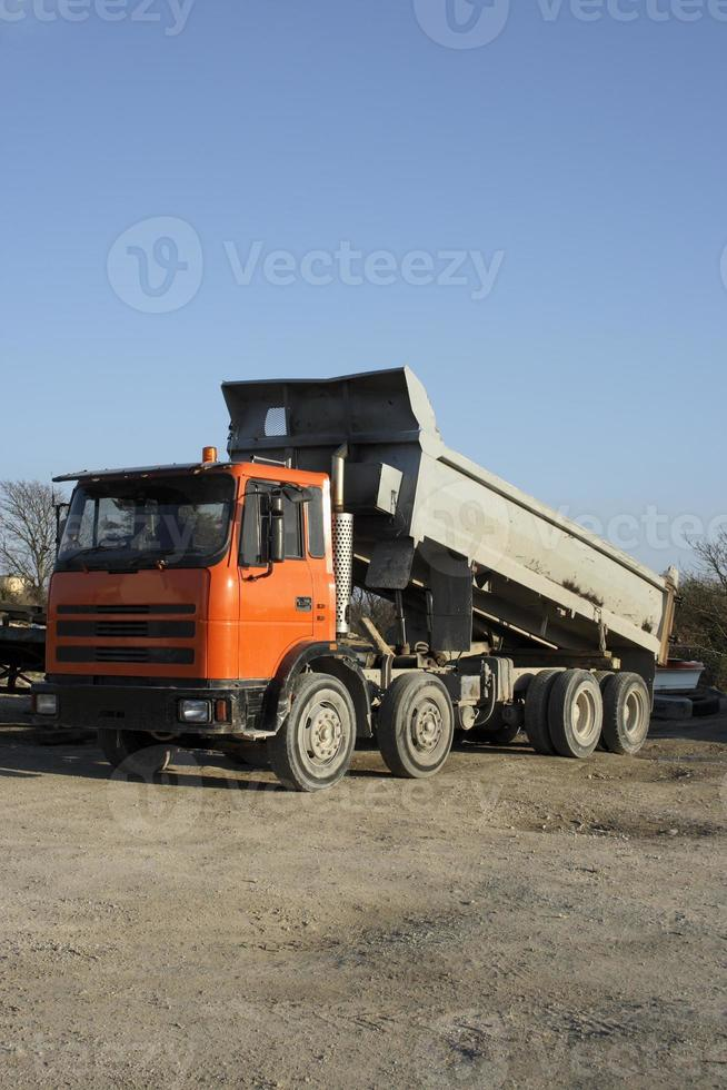 Dump truck tipping load. photo