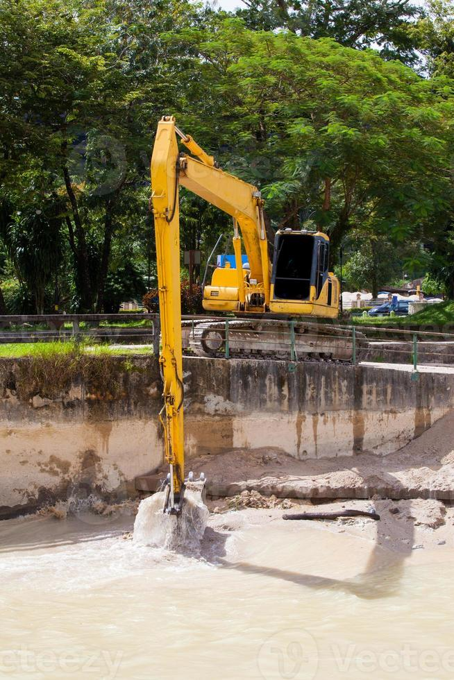 Excavator with metal tracks at construction site photo