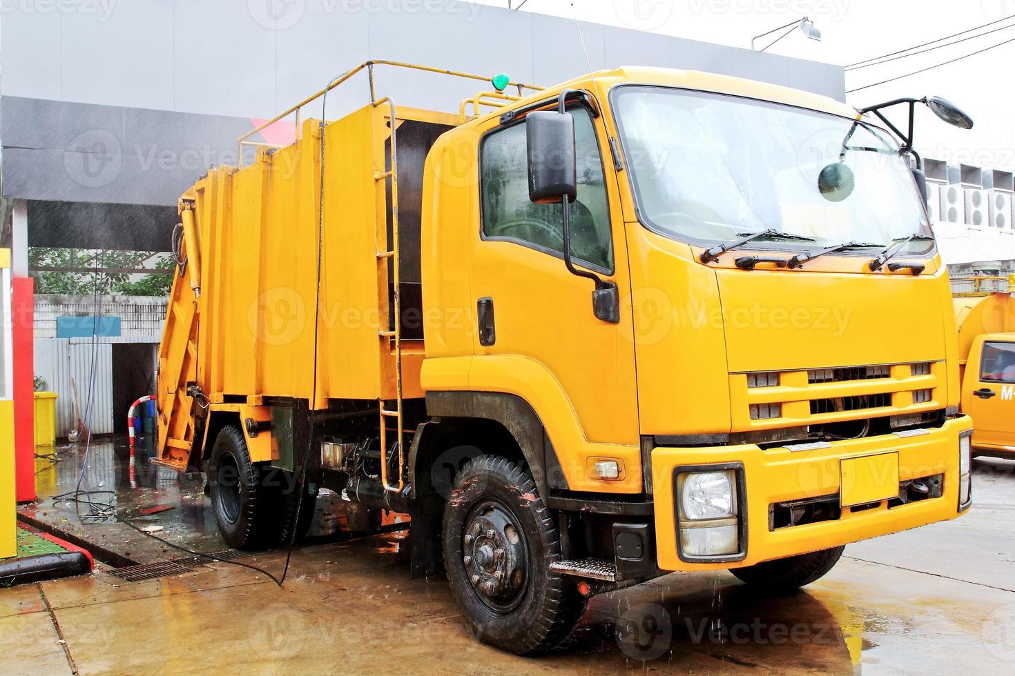 Yellow garbage truck photo