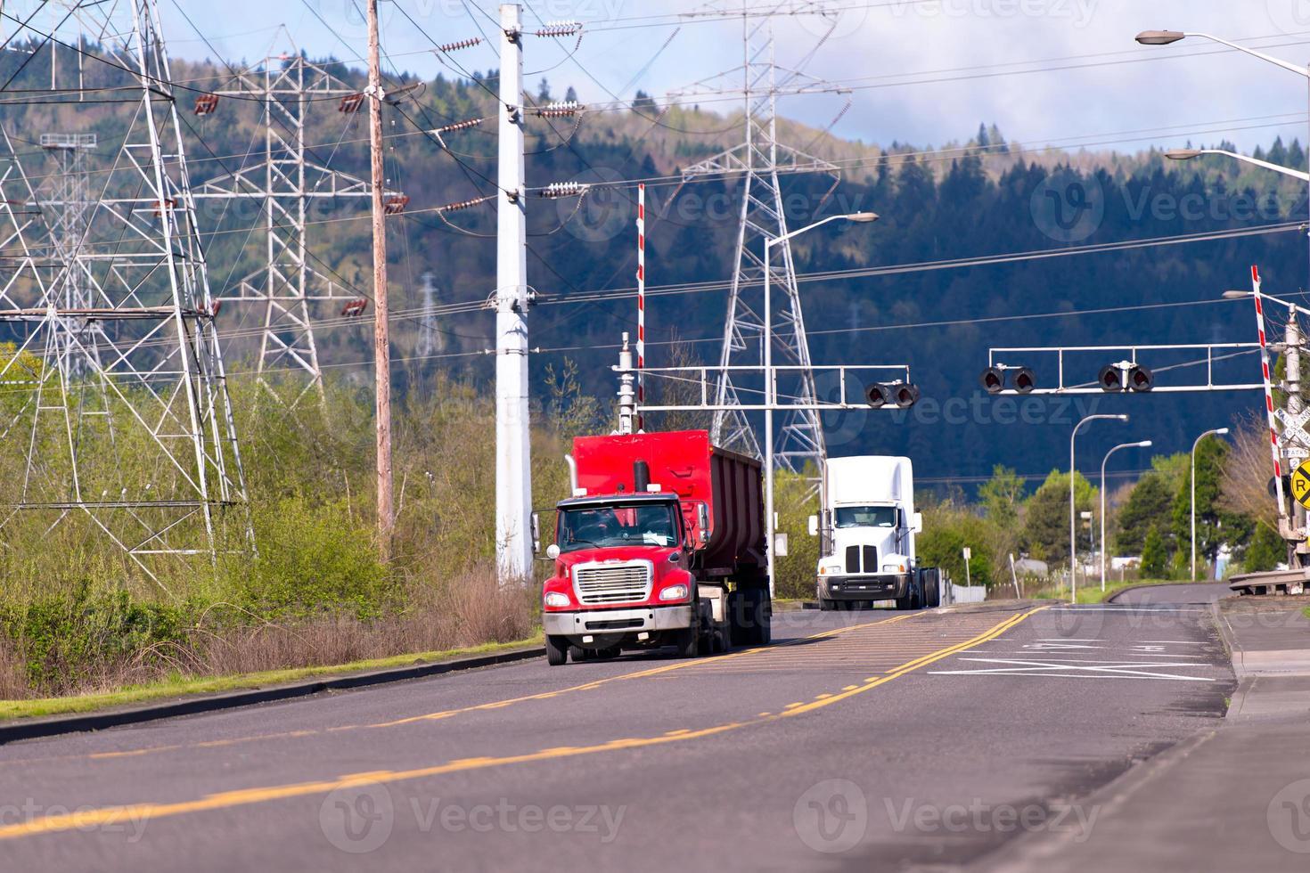 Semi trucks on the road in industrial zone photo