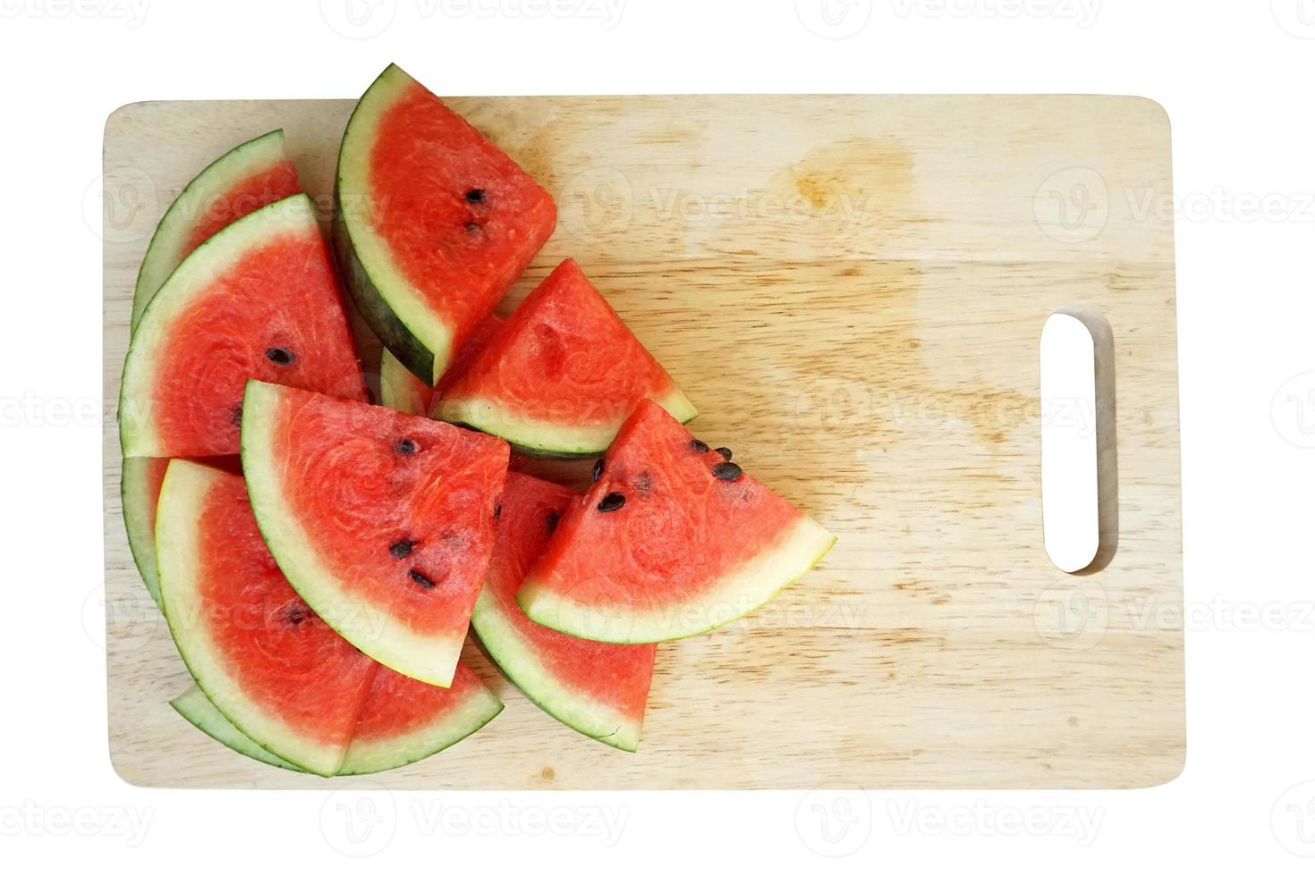 sliced watermelons on wooden plate, isolated on white background photo