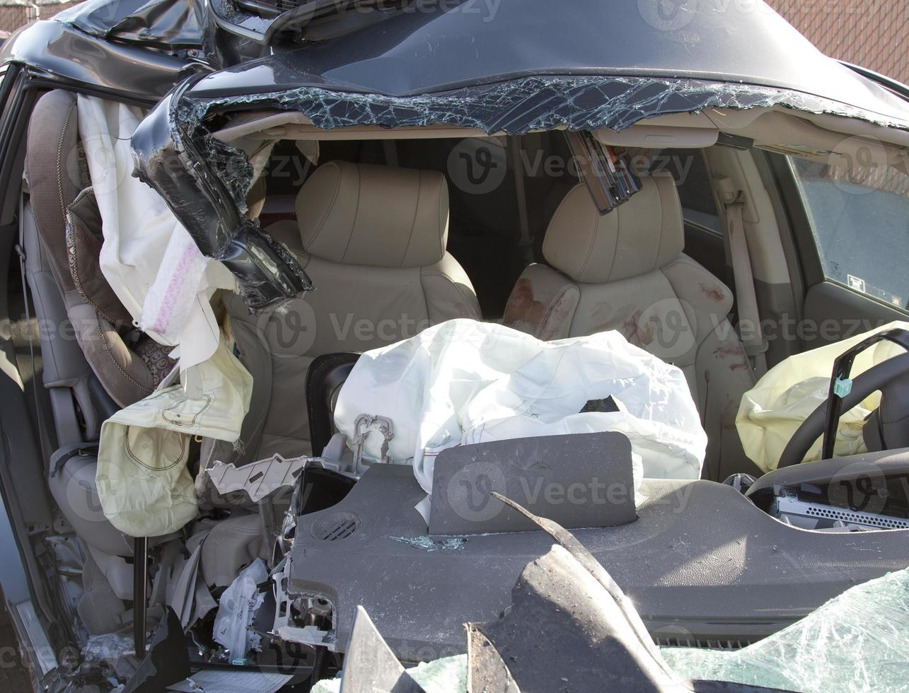 A destroyed car from the front that after a fatal car crash photo