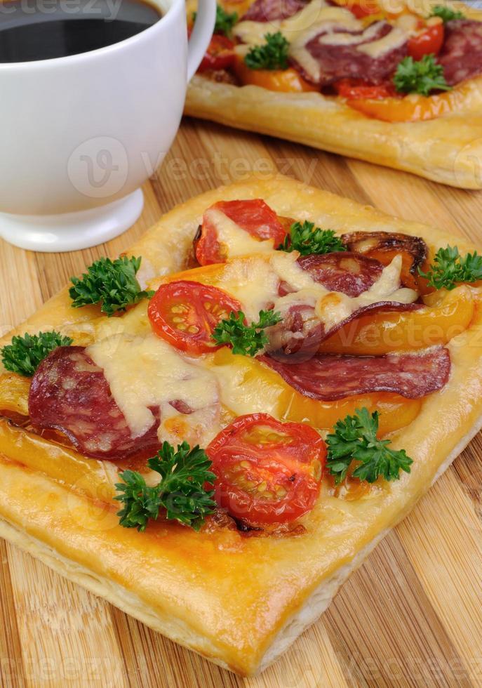 Mini pizza with salami photo